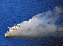 Smokey aerial view of the anchored Gen. Hoyt S. Vandenberg