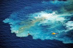 Helicopter and small boat remain after the sinking of the Vandenberg 7 miles from Key West